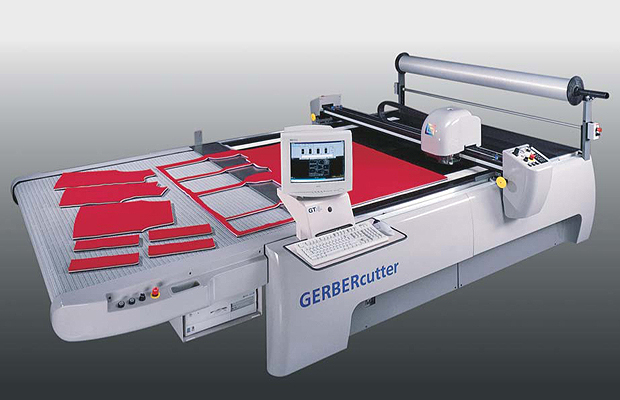 Fabric die cutting machine using GERBERcutter to cut out dyed textiles.